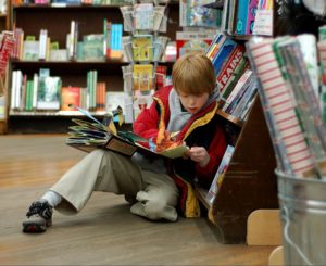 1280px-Child_reading_at_Brookline_Booksmith