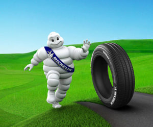 Michelin Man Rolling a Tire